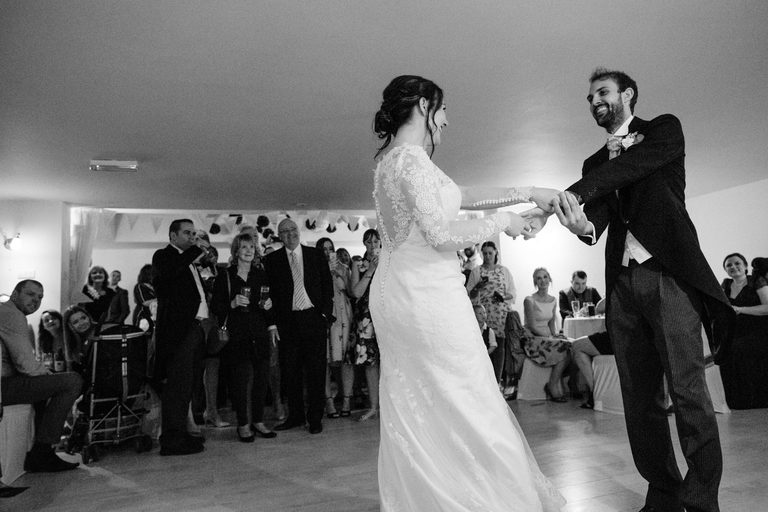 Couple smiling as they have their first dance