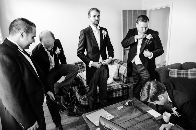 Groom and groomsmen getting ready to leave the house