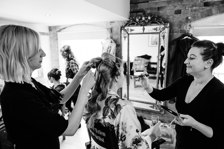 bride at west mill dressing room having make up done