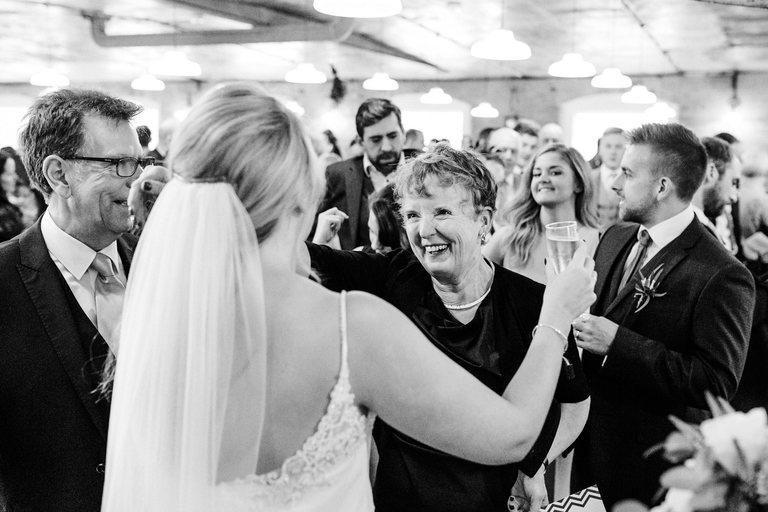 groom's mother hugs her new daughter-in-law