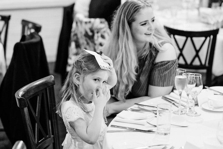 little girl picking her nose during wedding breakfast