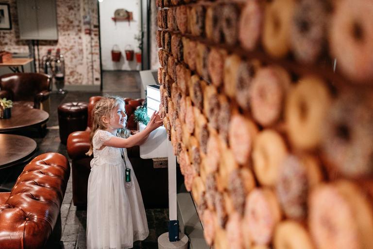 little girl and a doughnut wall