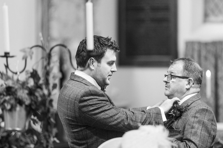 groom fixing his dads tie