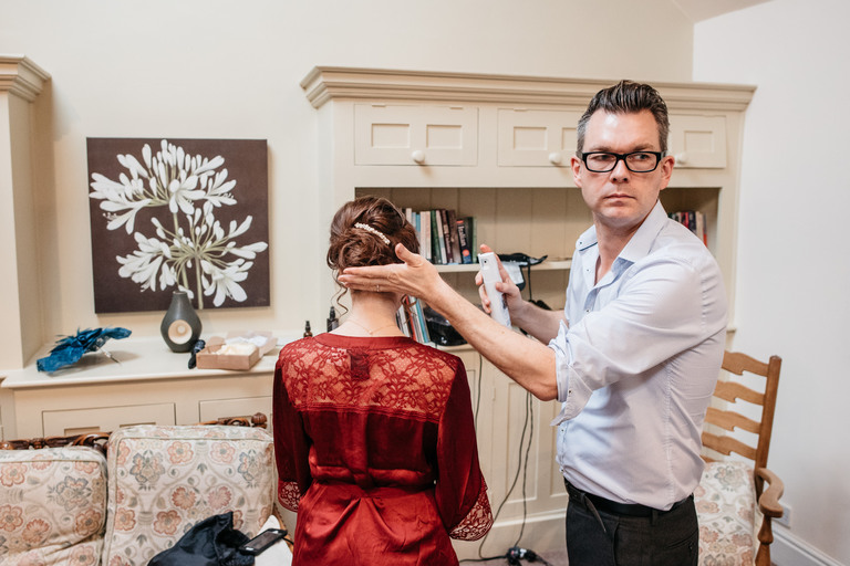 hair stylist chris fordham working on a bridesmaid
