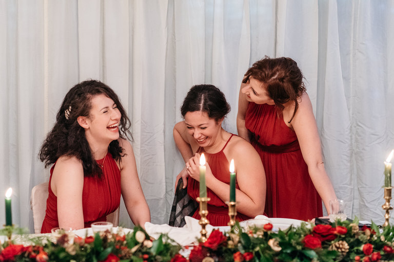 bridesmaids sharing a joke at the top table