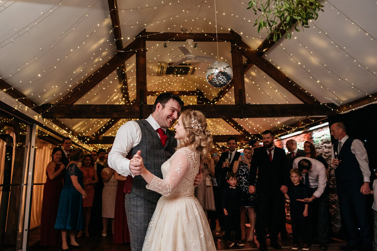 smiling couple have their first dance