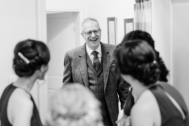 father of the bride arrives during bridal prep