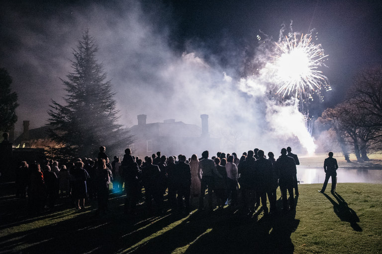 silhouette of wedding guests during fireworks