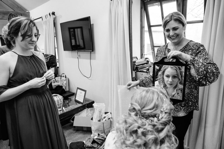 make up artist claire bryce finishes off with the bride