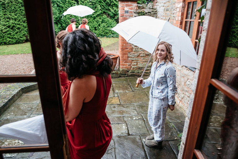 bride in pyjamas with an umbrella