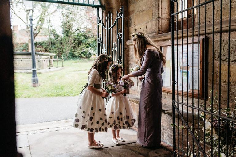 bridesmaid and flower girls waiting at church