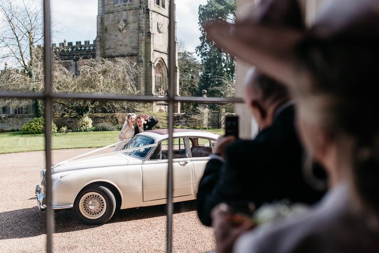 bride and groom outside staunton harold hall