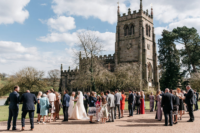 guests gathering in front of staunton harold church