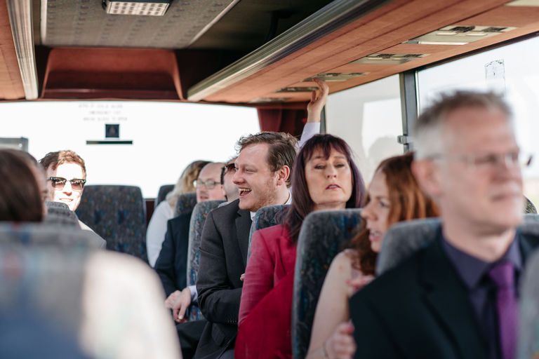 guests on a coach to wedding venue