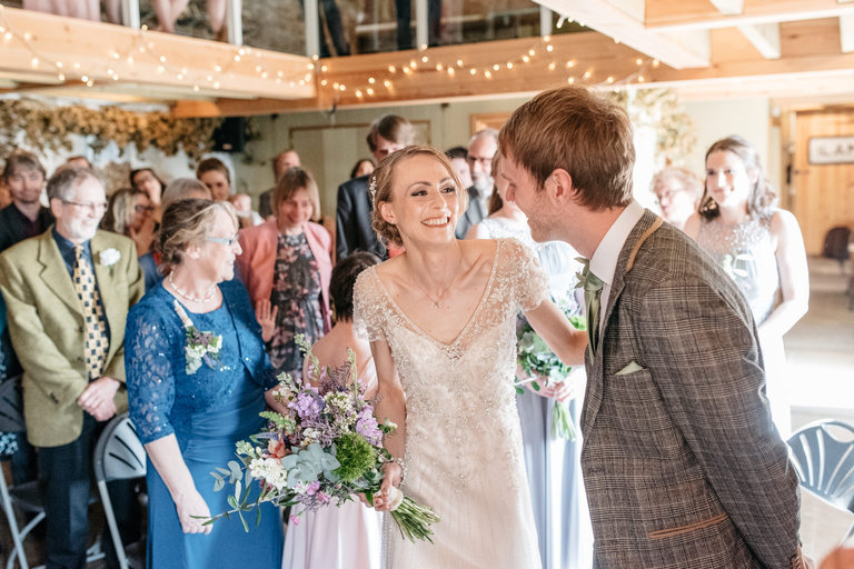 bride smiling at her new husband