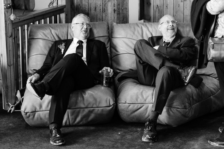 two gents sitting down chatting