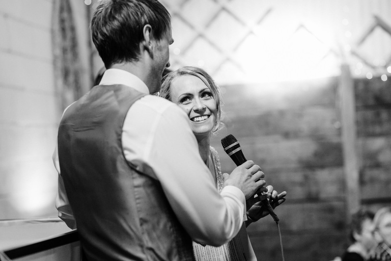 bride and groom giving a speech