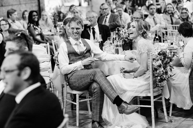 couple laughing at the speeches