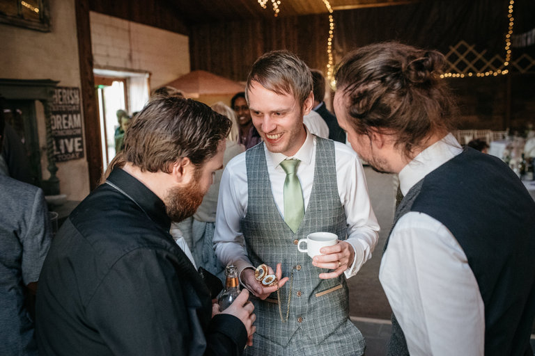 groom showing off his pocket watch