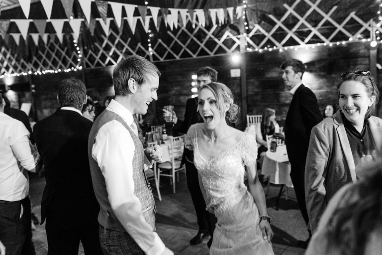 excited bride on the dance floor