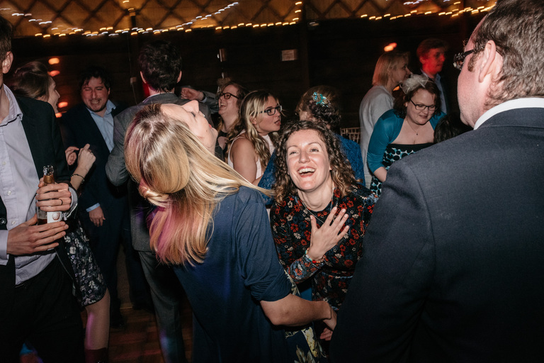 women laughing on the dance floor