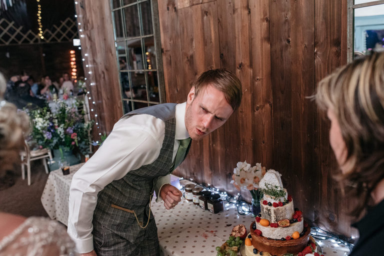 groom smelling the cheese cake