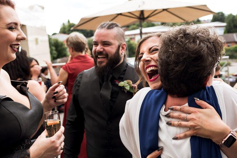 happy smiley wedding guest hug