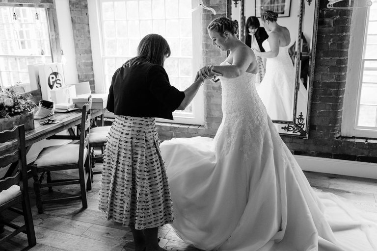 bride in her dress with her mum