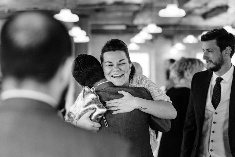happy guest hugging groom