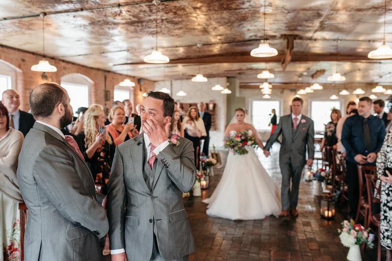 emotional groom as bride walks down the aisle