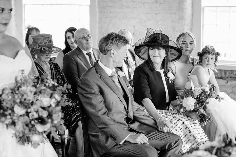 bride's parents exchange happy look