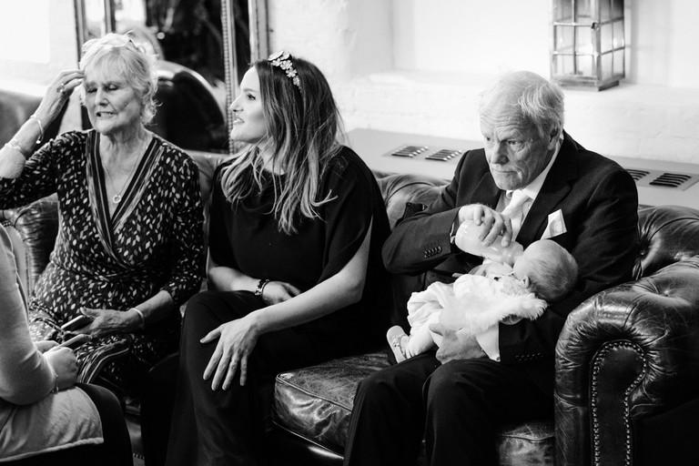granddad feeding the baby