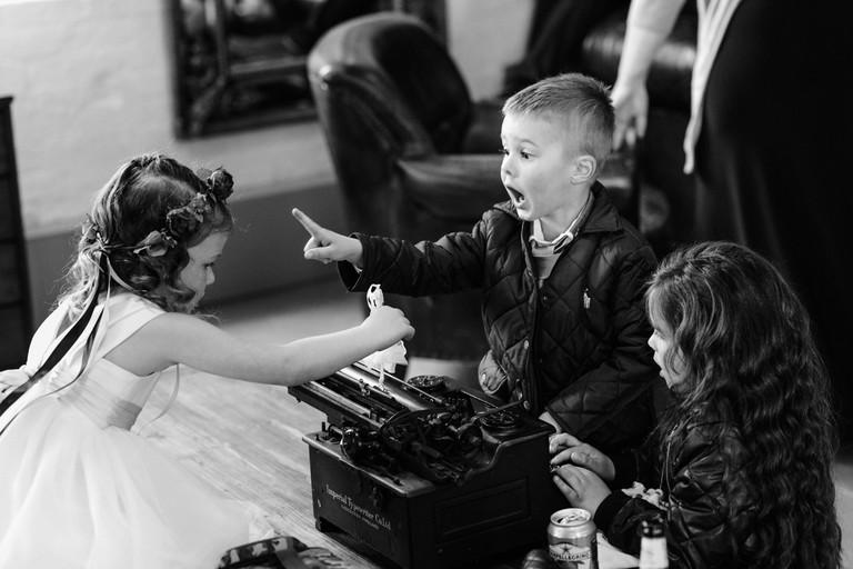 kids arguing over a vintage typewriter