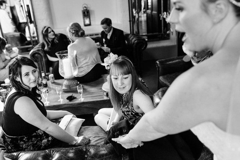 bride's friends admire her ring