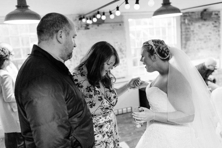 evening guest admires bride's dress