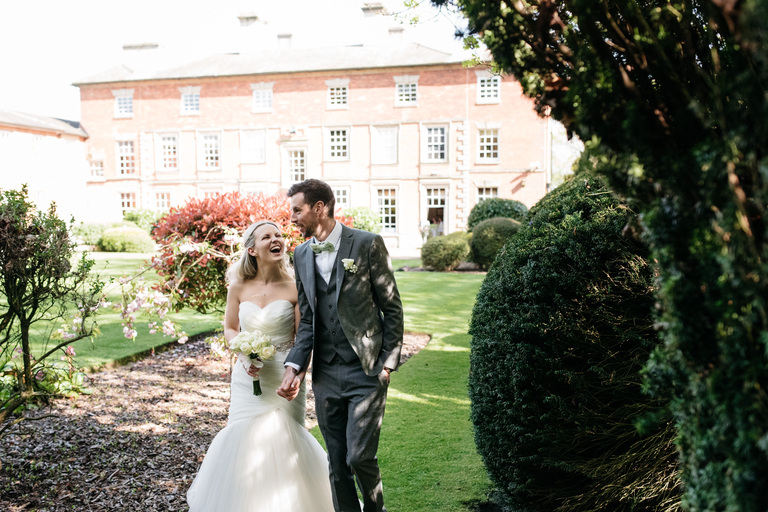 newlyweds walking through the grounds of ansty hall