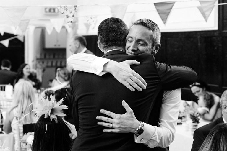 hugging the groom