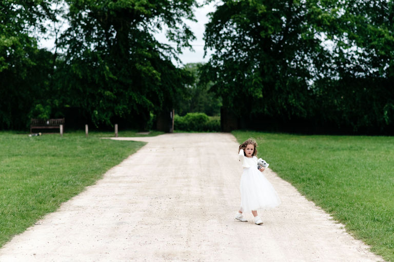 flower girl on the driveway