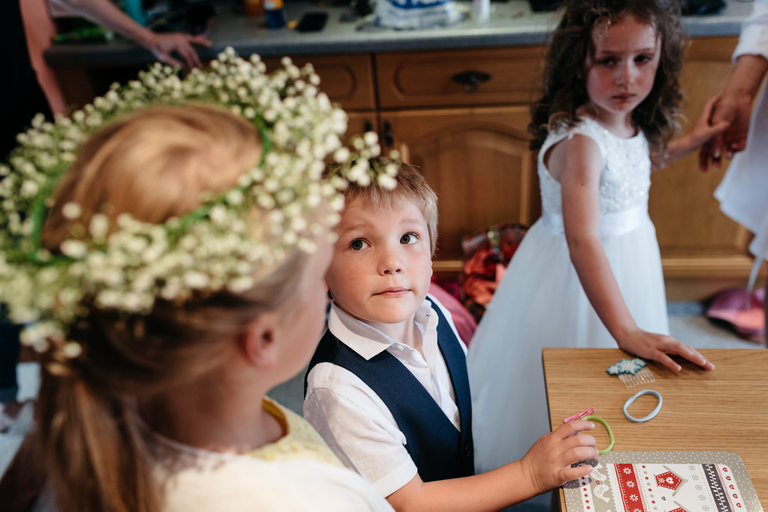 page boy looking at flower girl