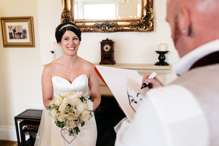 bride having her caricature drawn