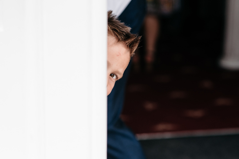 kid peeking around a door
