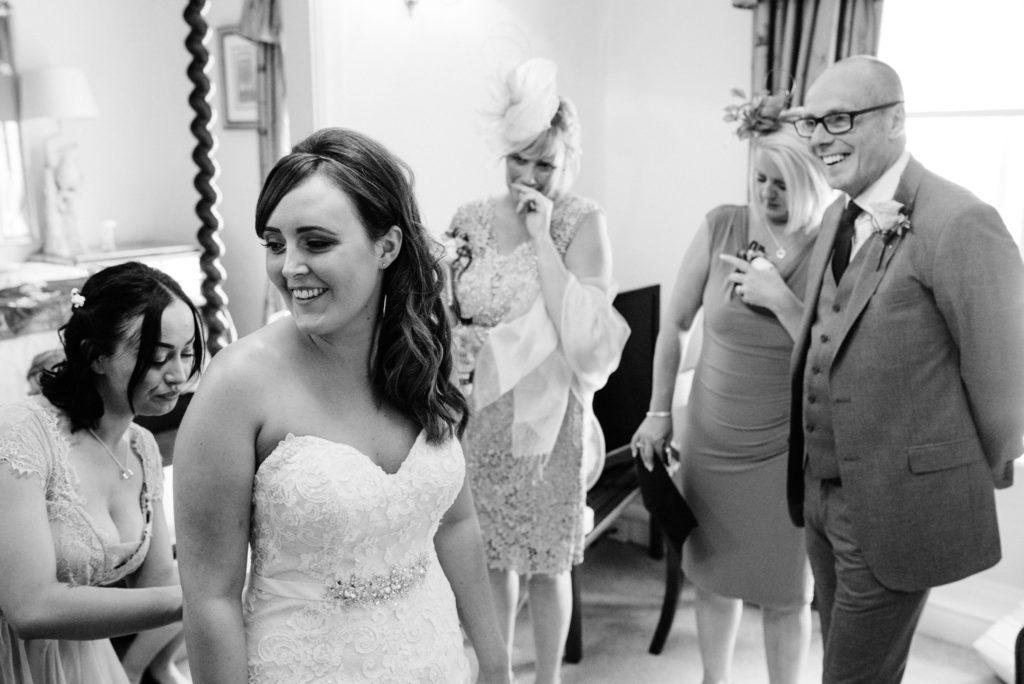 brides parents see the wedding dress