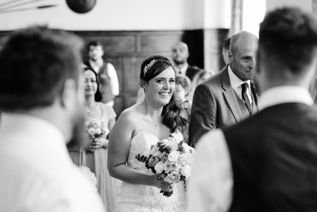 emotional bride walking down the aisle