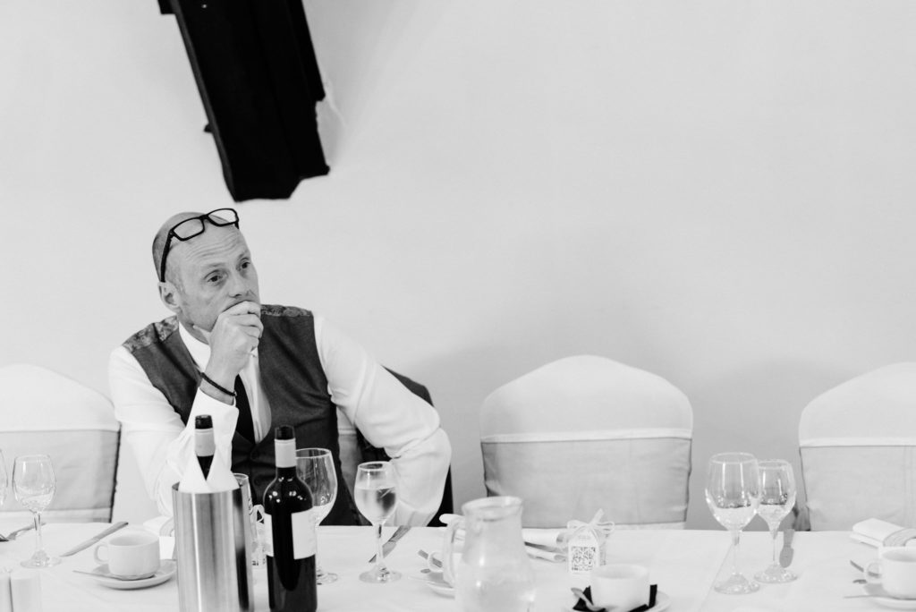 bride's father waits nervously for speeches