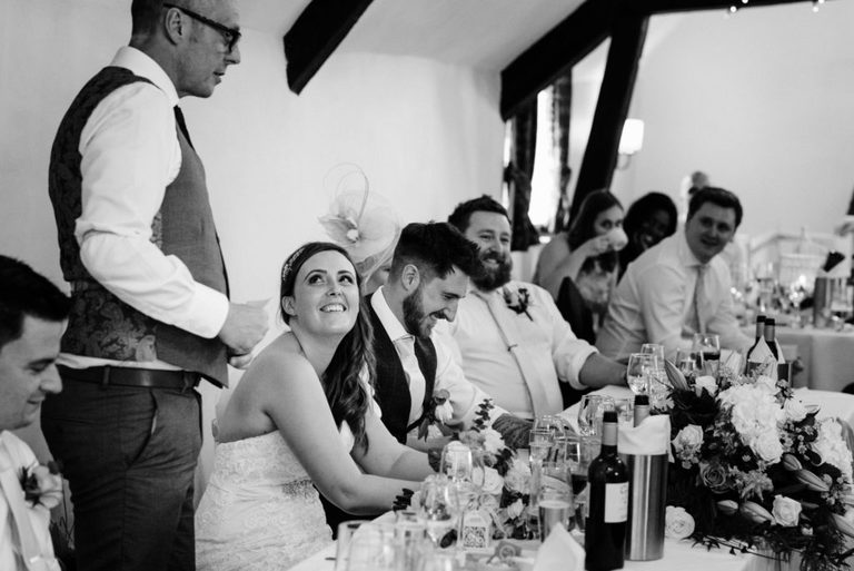 bride looks up at her dad during his speech