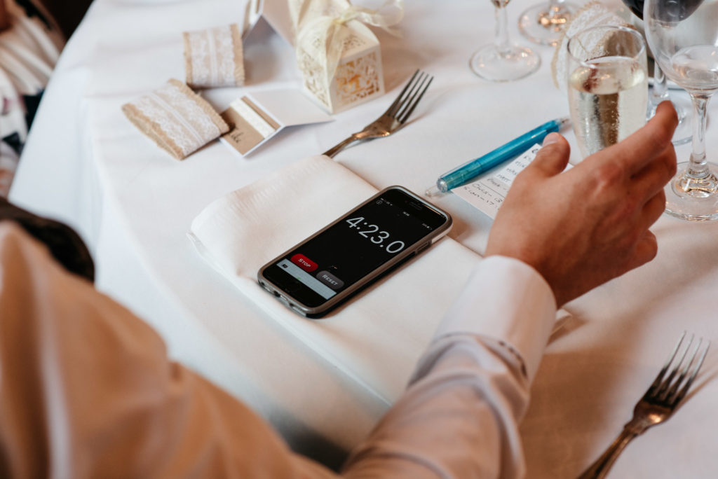 guests time the speeches on a phone