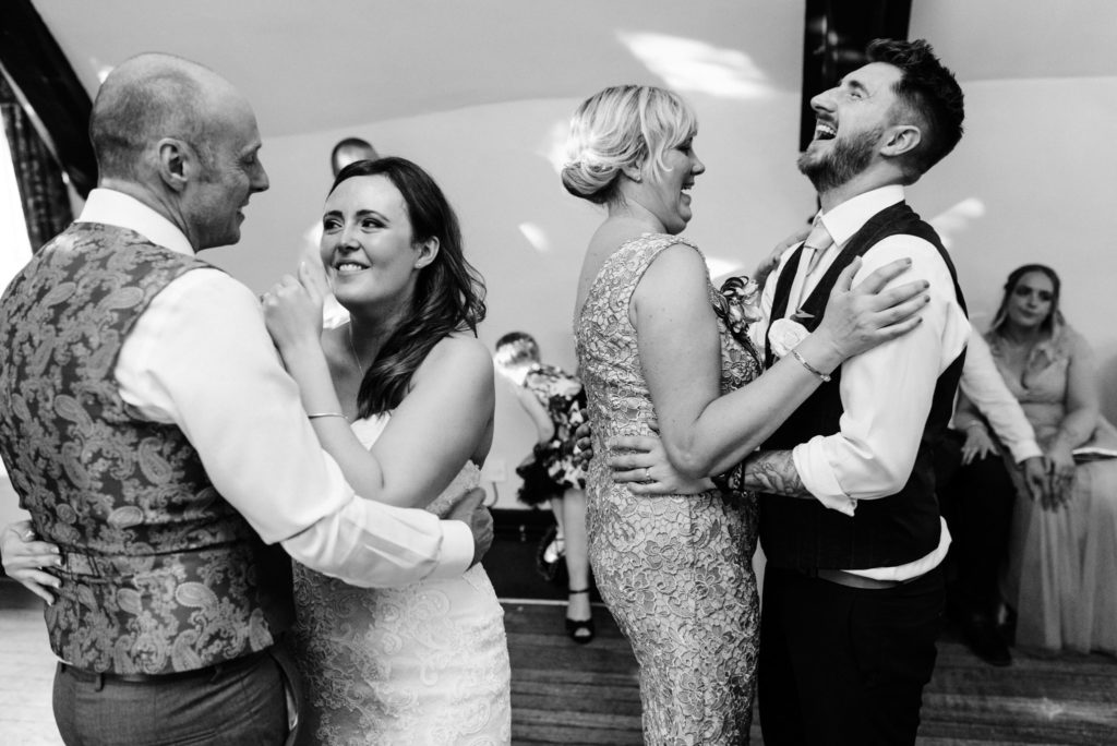 laughing and dancing with parents