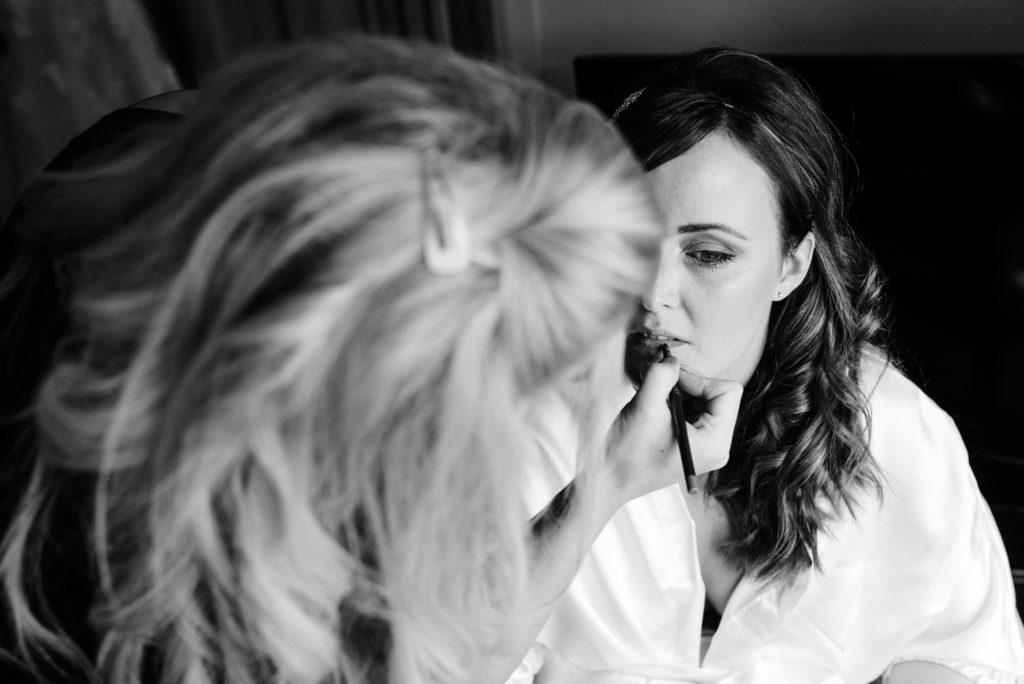 bride having her make up applied