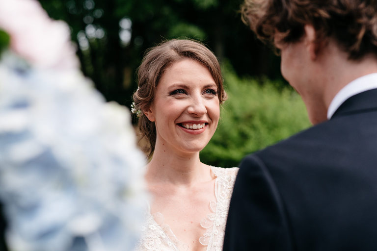 happy, smiling bride during her ceremony