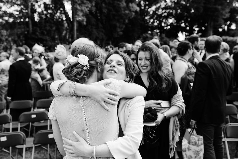 guest hugging bride after ceremony